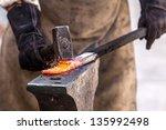 Blacksmith Working On Metal On...
