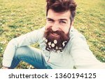hipster on smiling face sits on ... | Shutterstock . vector #1360194125