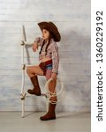 little girl in a wide brimmed... | Shutterstock . vector #1360229192