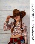 little girl in a wide brimmed... | Shutterstock . vector #1360229198