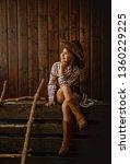 little girl in a wide brimmed... | Shutterstock . vector #1360229225