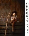 little girl in a wide brimmed... | Shutterstock . vector #1360229228