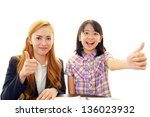 english teacher with student | Shutterstock . vector #136023932