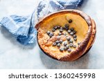 dutch baby with blueberries ... | Shutterstock . vector #1360245998