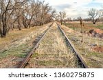 abandoned  railroad tracks in a ... | Shutterstock . vector #1360275875