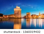 Small photo of sunset over the city of La Rochelle in France