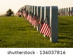 Stock photo endless row of white marble gravestones continues above hilltop at the fort logan national cemetery 136037816