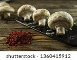 fresh mushrooms with spices on... | Shutterstock . vector #1360415912