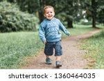 little boy play in the park. | Shutterstock . vector #1360464035