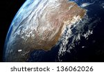 unidentified object flying over the earth - stock photo