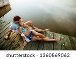 loving couple sitting on the... | Shutterstock . vector #1360869062