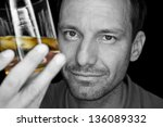 Man Looking At Golden Whiskey...