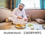 middle eastern man wearing... | Shutterstock . vector #1360894892