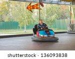 Senior Man In Small Car At The...