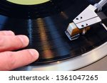 Small photo of Scratching using a vinyll record on a turntable with tone arm