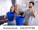 couple using bucket for... | Shutterstock . vector #1361079788