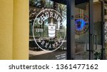 Small photo of Irvine, California/United States - 03/29/19: A window decal sign for the ice cream chain known as Churned Creamery