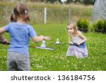 Kids Playing Badminton On...