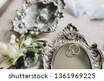 wedding rings lie on a vintage... | Shutterstock . vector #1361969225