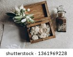 on the table in a wooden box... | Shutterstock . vector #1361969228