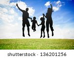 silhouette of jumping family... | Shutterstock . vector #136201256