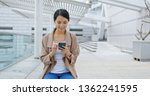 woman use of mobile phone online   Shutterstock . vector #1362241595