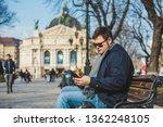 man eating burger surfing... | Shutterstock . vector #1362248105
