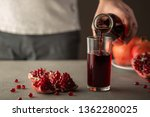 male hand pouring pomegranate... | Shutterstock . vector #1362280025
