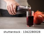 male hand pouring pomegranate... | Shutterstock . vector #1362280028