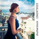 beautiful woman on a balcony in ... | Shutterstock . vector #1362473315