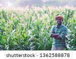 African Farmer With Hat Stand...