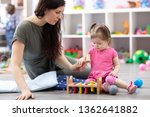 cute baby playing with carer or ... | Shutterstock . vector #1362641882