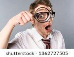 Shocked Businessman In Glasses...