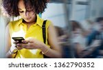 young woman using a smartphone...   Shutterstock . vector #1362790352