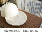 Breakfast served composition: ceramic salver with white empty copyspace dish over glass table - stock photo