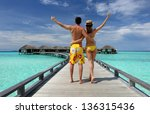 couple on a tropical beach... | Shutterstock . vector #136315436