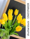 a bouquet of yellow tulips on a ... | Shutterstock . vector #1363196828