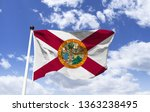 Small photo of Model of the Florida flag in the wind. One of the official symbols of the Department of Florida, southeastern US. Motto: In God we trust, printed on the reverse of the dollar bills.