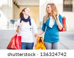 two young women with shopping... | Shutterstock . vector #136324742