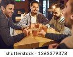 friends talk  drink beer in a... | Shutterstock . vector #1363379378