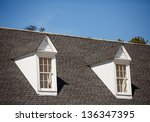 two white wood dormers on a... | Shutterstock . vector #136347395