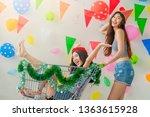 two asian woman enjoying in... | Shutterstock . vector #1363615928