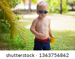 child with suntan lotion shaped ... | Shutterstock . vector #1363756862
