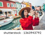beautiful tourist takes photos... | Shutterstock . vector #1363943792