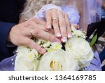 hands with rings on the fingers ... | Shutterstock . vector #1364169785