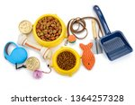 Small photo of Pet supplies on white background, top view. Leash, brush, scoop, toys and food. Essentials to keep your animal happy and healthy.