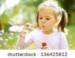 cute little girl is blowing a...   Shutterstock . vector #136425812