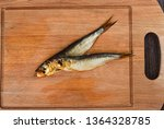 Stock photo two baltic herrings cold smoked on a wooden cutting board two aromatic baltic herrings smoked 1364328785