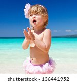 happy little girl having fun on ... | Shutterstock . vector #136441952