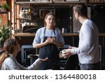 Stock photo hostile angry restaurant client couple or friends talking with waiting staff in public place 1364480018